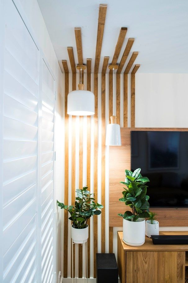 wood slats accent wall onto the ceiling
